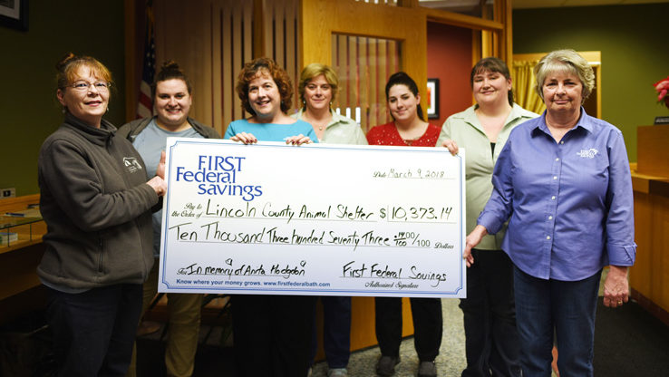 The Lincoln County Animal Shelter accepts a donation from First Federal Savings in memory of Anita Hodgdon. From left: Tammy Walsh and Katie Buehrer, of the shelter; First Federal Savings Vice President Jean Huber; and bank employees Laurie Simmons, Nichole Whitney, Sylviann Ward, and Sunni Gail Page. (Jessica Picard photo)