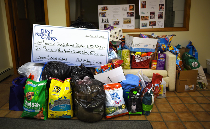 First Federal Savings donated $10,373.14 and animal care supplies to the Lincoln County Animal Shelter in memory of Anita Hodgdon on Friday, March 9. (Jessica Picard photo)