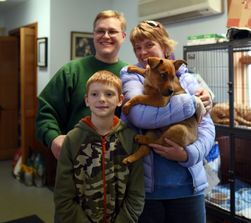 The Mozer family poses for a photo with Cub, the 12-week-old puppy they adopted during the Puppy Palooza event at the Lincoln County Animal Shelter in Edgecomb on Saturday, March 3. (Jessica Picard photo)
