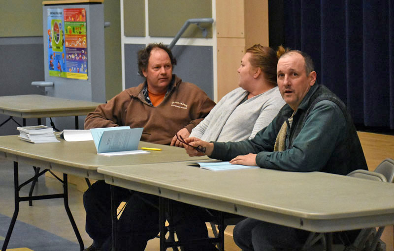 The Jefferson Board of Selectmen discusses the upcoming annual town meeting by referendum during a public hearing at Jefferson Village School on Thursday, March 8. From left: Jigger Clark, Pamela Grotton, and Gregory Johnston. (Alexander Violo photo)