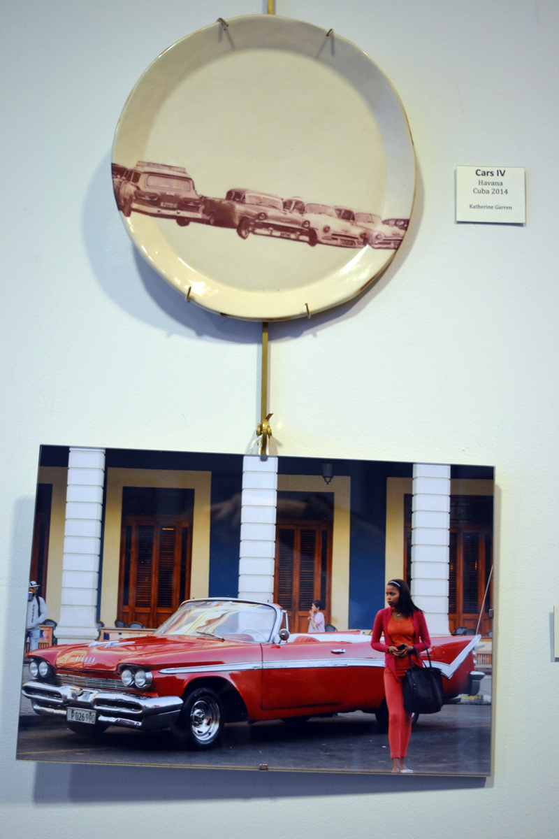 """Cars IV,"" by Katherine Garren, hangs above ""Cars III,"" by Gisela H. Rhodes, at the ""Viva Cuba"" photography show on the walls of The Carey Gallery at Skidompha Library. (Christine LaPado-Breglia photo)"