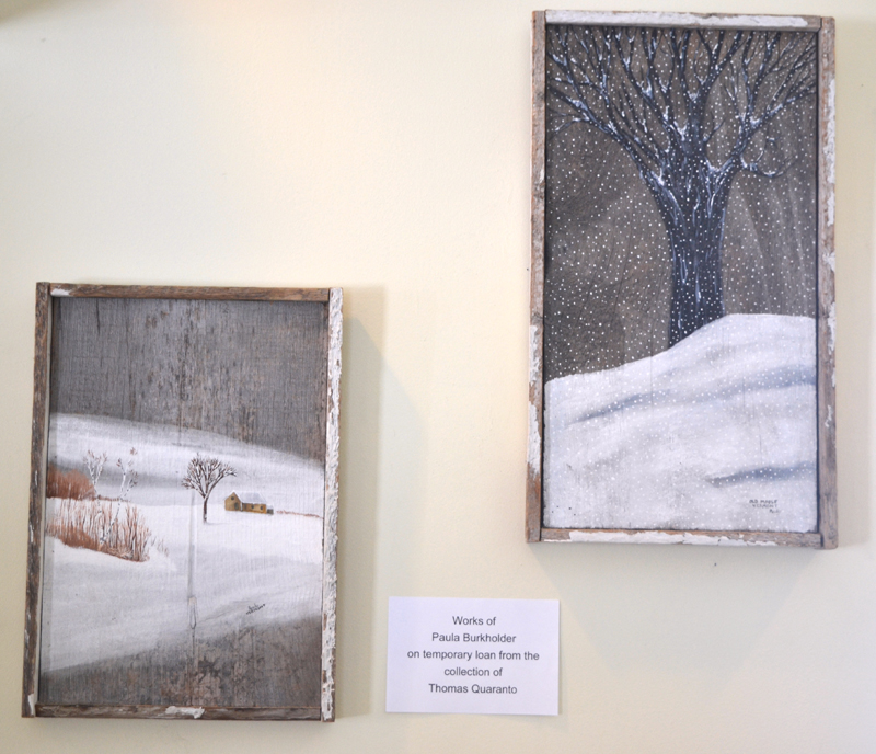 Two winter scenes painted on reclaimed barnwood by Paula Burkholder, on loan to the Wiscasset Public Library from the collection of Thomas Quaranto. (Christine LaPado-Breglia photo)