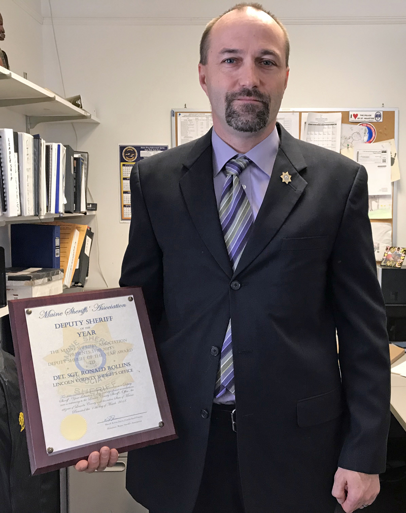 Lincoln County Sheriff's Office Detective Sgt. Ronald Rollins displays his 2018 Deputy Sheriff of the Year plaque in his Wiscasset office Thursday, March 22. (J.W. Oliver photo)