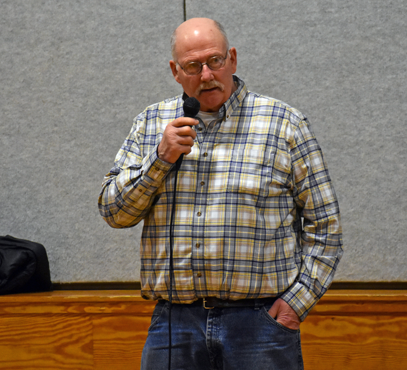 Nobleboro Selectman Richard Powell discusses upcoming repairs to the sidewalks in Damariscotta Mills during town meeting in the Nobleboro Central School gymnasium Saturday, March 17. (Alexander Violo photo)