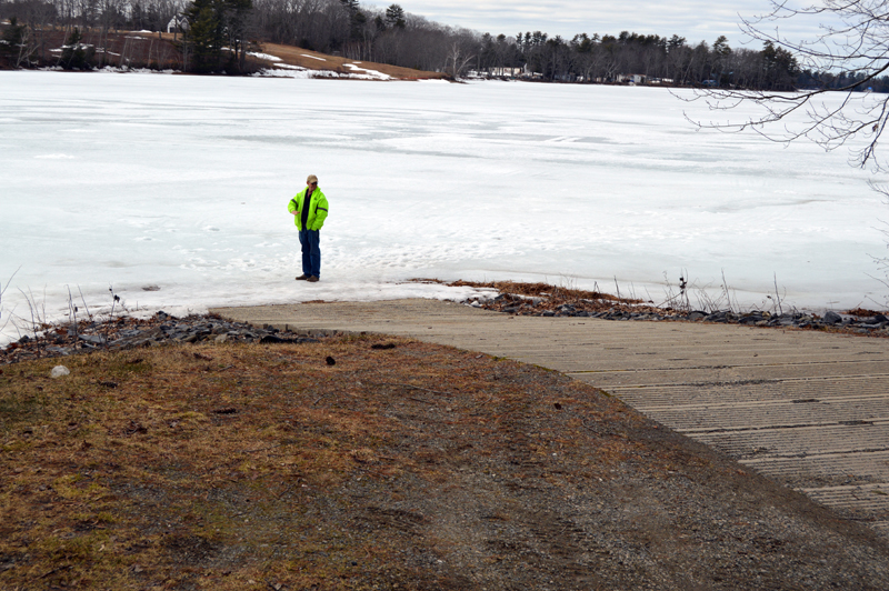 Clary Lake property owner George Fergusson stands on the ice at the boat ramp in Jefferson to show the lake's low water level. (Greg Foster photo)