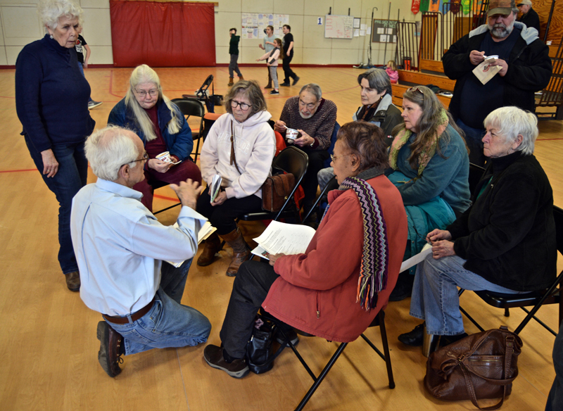 Whitefield Selectman Bill McKeen discusses a survey on recreational marijuana with a small group of residents after adjournment of the annual town meeting Saturday, March 17. (Greg Foster photo)