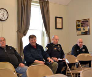 Wiscasset department heads sit in the back row of the town office's meeting room Monday, March 26, ready to explain their budgets to the selectmen and budget committee. From left: Wastewater Treatment Plant Superintendent Buck Rines, Road Commissioner Doug Fowler, Police Chief Jeffrey Lange, and Ambulance Service Director Toby Martin. (Charlotte Boynton photo)