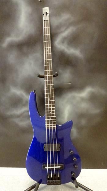 A cobalt-blue NS Wav 4 Radius bass guitar.