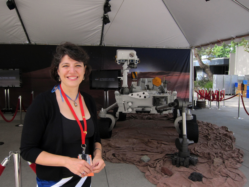 Aileen Yingst with a mockup of the Curiosity rover.