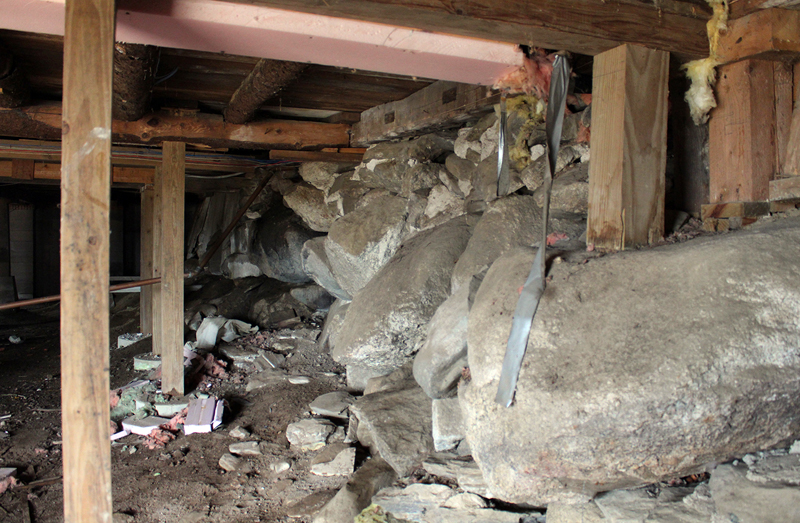 Years of damage from rodent and insect activity and water have caused the foundation under the barn to shift significantly and sink at the southwest corner (right foreground).
