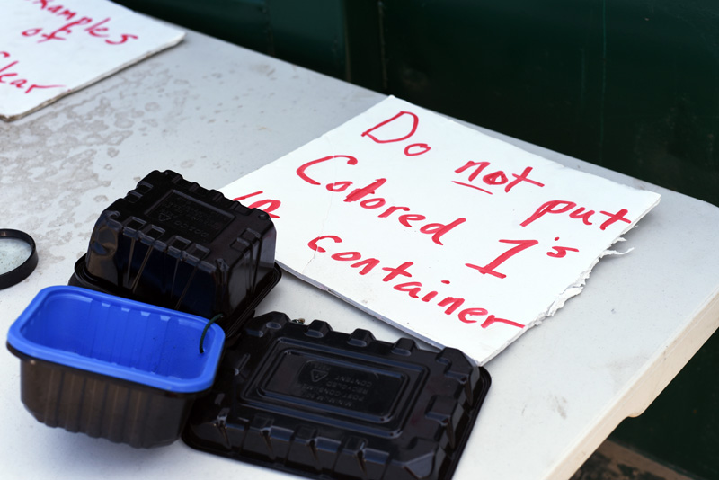 A sign at the Nobleboro-Jefferson Transfer Station, with samples, provides guidance on the type of #1 plastics the station cannot accept for recycling. (Jessica Picard photo)