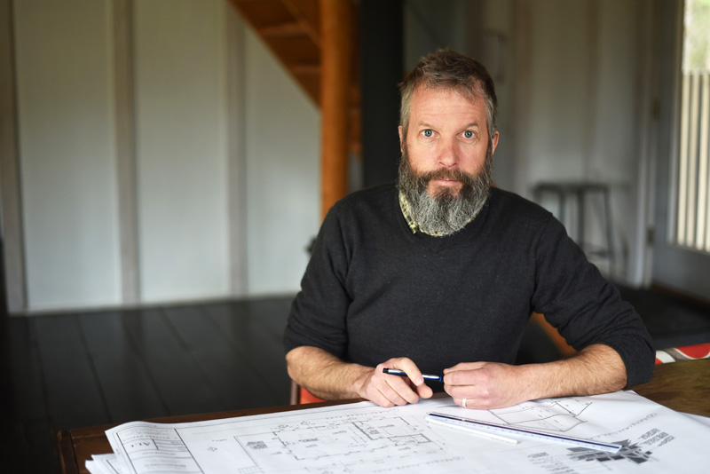 Adam Maltese sits in his Damariscotta home, where he works as an architectural designer, Thursday, April 19. (Jessica Picard photo)