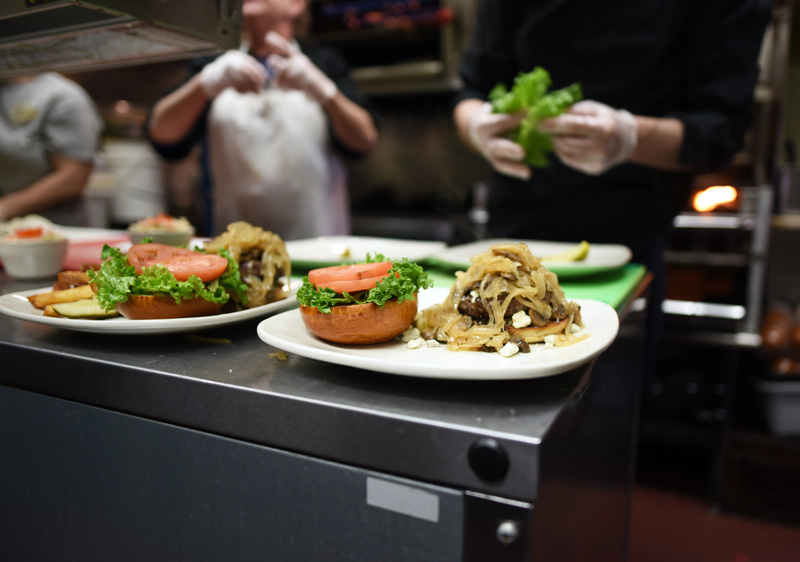 Food is prepared in the kitchen of King Eider's Pub on Monday, April 2. (Jessica Picard photo)