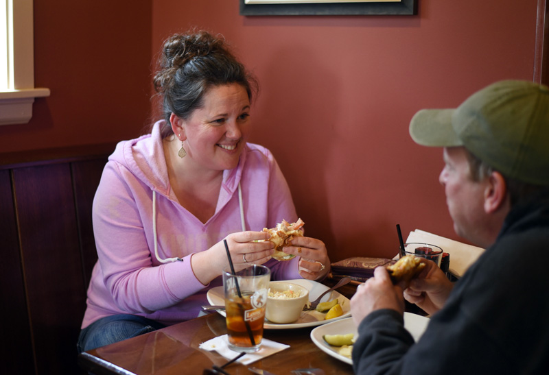 Stephanie and Todd Vincentsen, of Bristol, eat at King Eider's Pub on Monday, April 2. (Jessica Picard photo)