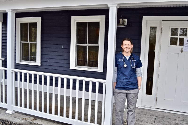 Dr. Susan Bailey stands on the porch that inspired the name of her new clinic, Porchside Veterinary Care, at 514 Gardiner Road in Dresden. (Greg Foster photo)