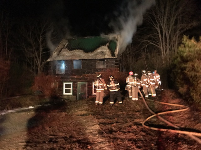 Area firefighters on the scene of a structure fire on Upper Round Pond Road in Bristol the evening of Sunday, April 15. (J.W. Oliver photo)