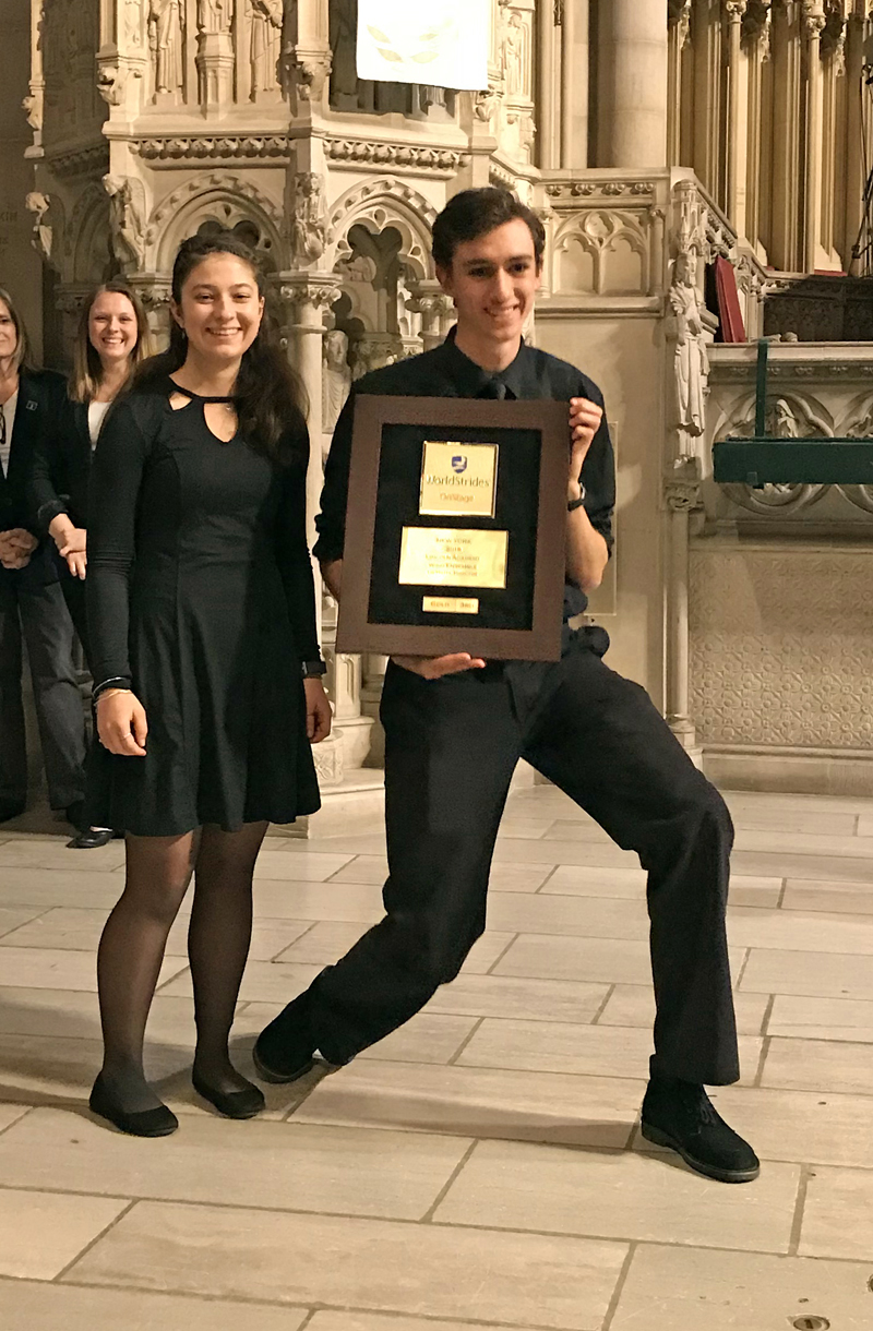 Seniors Emma Allen and Lauren Pusey Nazzaro collect the gold medal from the WorldStrides Heritage Festival judges for the LA Wind Ensemble's erformance in New York City.