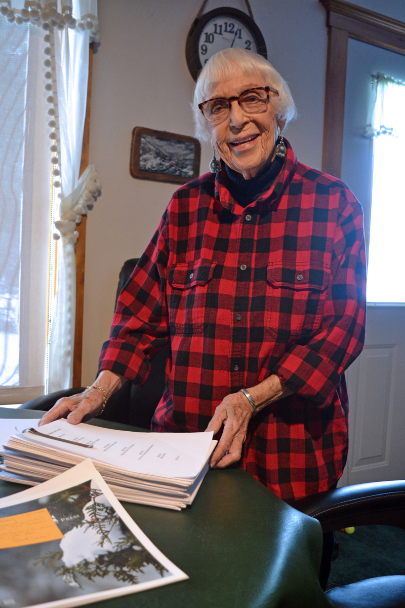 """Whitefield author May Davidson with the 377-page manuscript for her forthcoming book, """"Whatever It Takes,"""" scheduled to be published in May by Islandport Press. (Christine LaPado-Breglia photo)"""