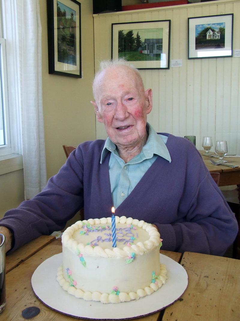 Arthur Jones, of Nobleboro, with his 100th birthday cake. (Photo courtesy Craig Masse)
