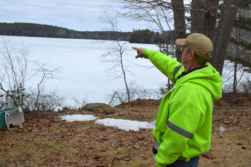 Clary Lake property owner George Fergusson points to his view of the lake in March. The Clary Lake Association is raising money to purchase the Clary Lake Dam and restore the lake's historical water level. (Greg Foster photo, LCN file)