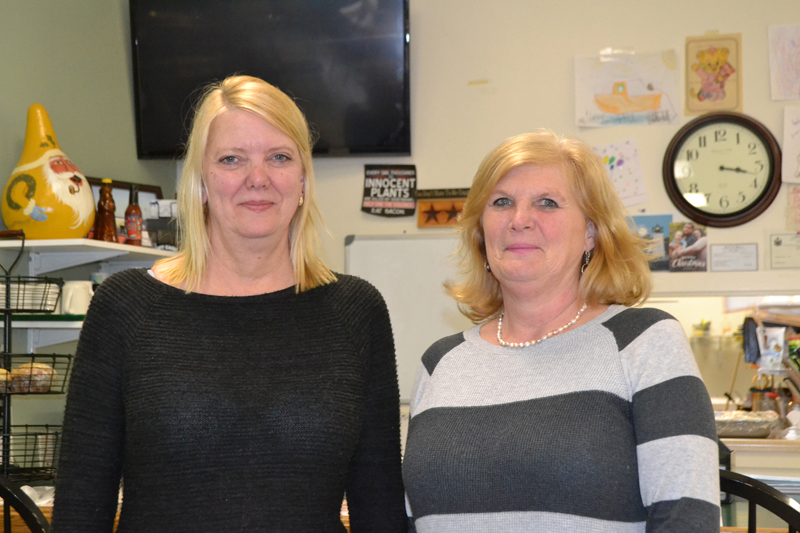 Marketplace Cafe owner Cindy Bradford (left) will soon sell the Wiscasset restaurant to employee Kelley Churchill and go to work for Churchill, her longtime co-worker and friend. (Charlotte Boynton photo)