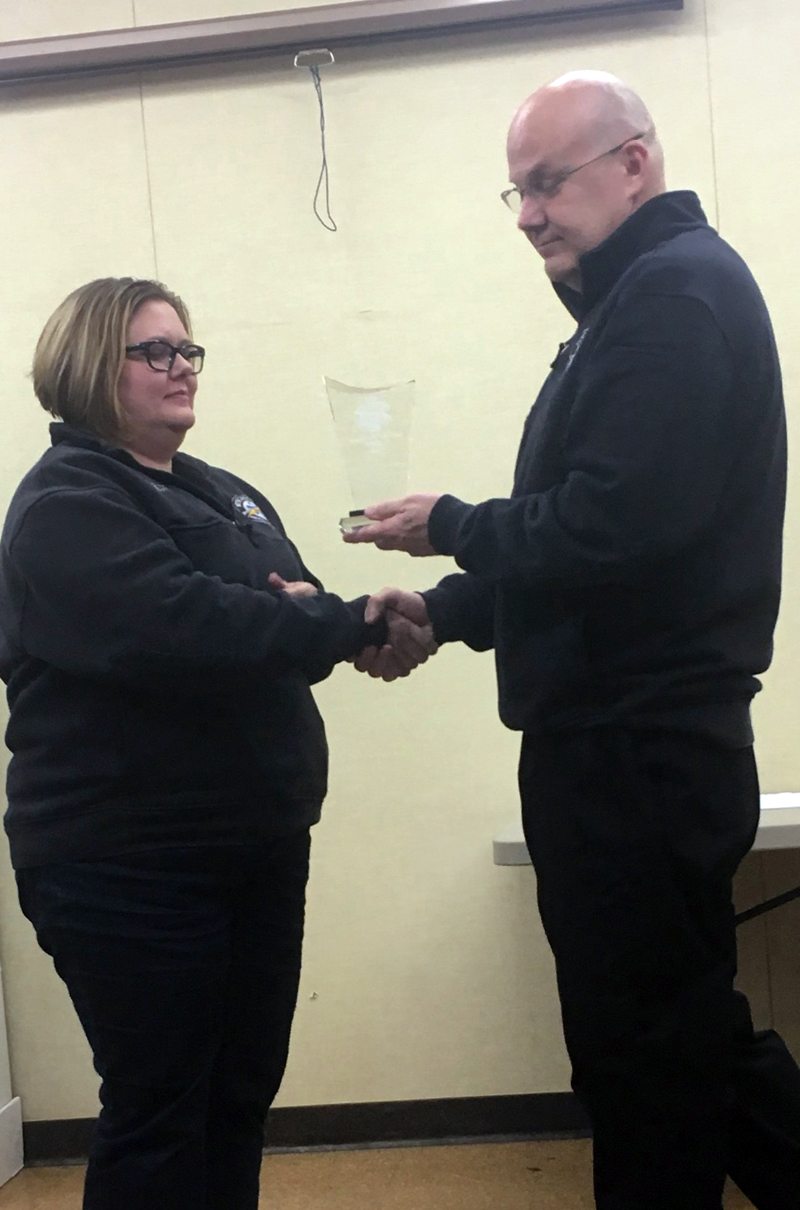 Wiscasset Ambulance Service Emergency Medical Technician Kristin Draper (left) receives the 2017 Employee of the Year trophy from Director Toby Martin.
