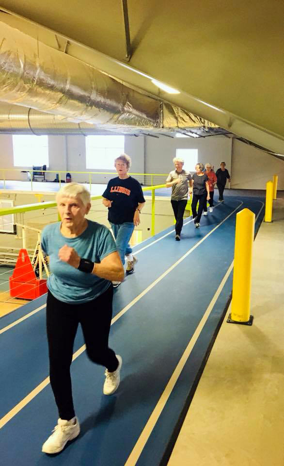 Members enjoy the CLC YMCA's new raised track.