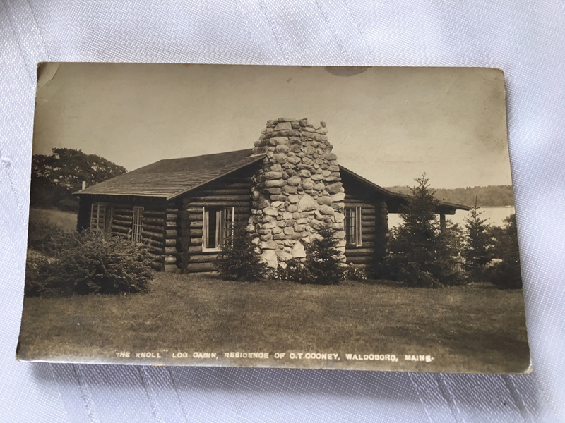 A photograph featuring the outside view of O.T. Cooney's original cabin, The Knoll.