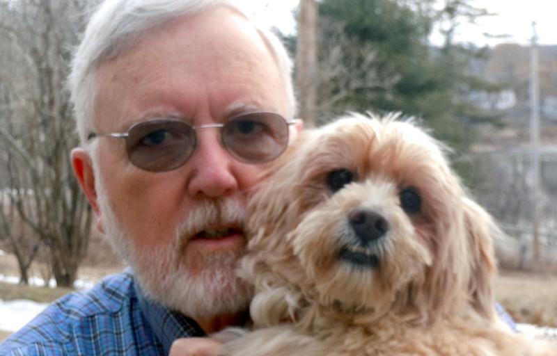 Organist Jay Zoller with a canine companion.