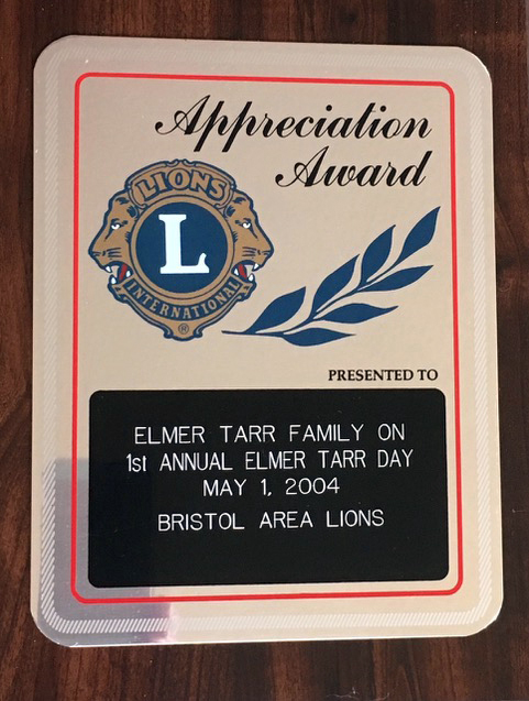 The award presented to the Elmer Tarr family by the Bristol Area Lions Cllub.
