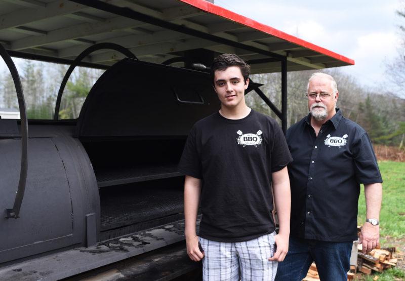 Wyatt Flower, 15, and his grandfather, Ken Flower, own Sweet Georgia BBQ. (Jessica Picard photo)