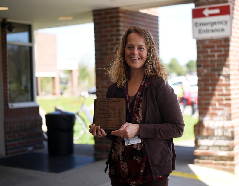 Megan Melville, LincolnHealth's safety specialist and emergency preparedness coordinator, stands in front of the hospital with her Oustanding Emergency Manager of the Year award Monday, May 7. (Jessica Picard photo)