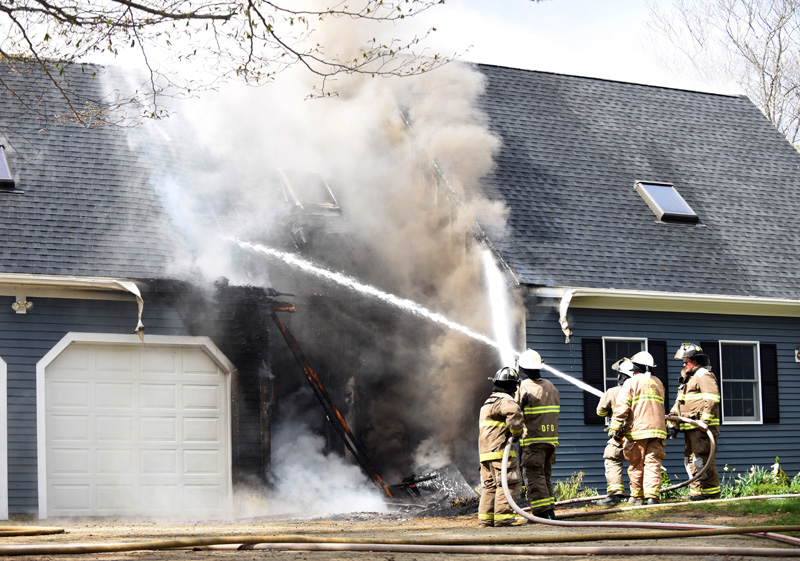 Firefighters attack a fire at 12 Woods Lane in Damariscotta the afternoon of Thursday, May 10. (Jessica Picard photo)