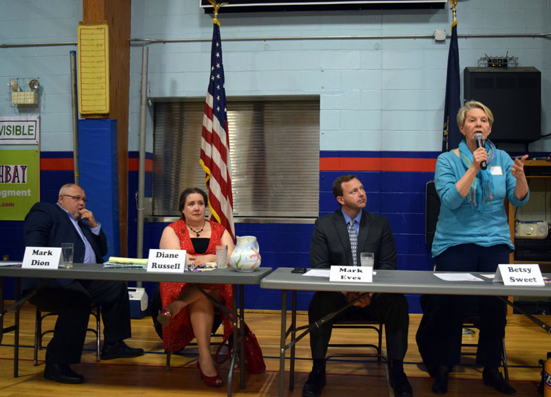 From left: state Sen. Mark Dion, Diane Russell, and Mark Eves listen to Betsy Sweet during a gubernatorial candidates forum at Great Salt Bay Community School in Damariscotta on Saturday, May 12. (J.W. Oliver photo)
