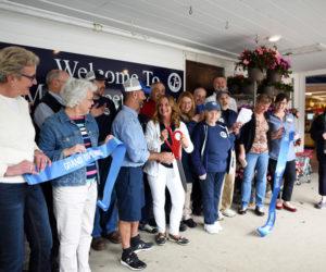 Main Street Grocery Cuts Ribbon at Grand Opening