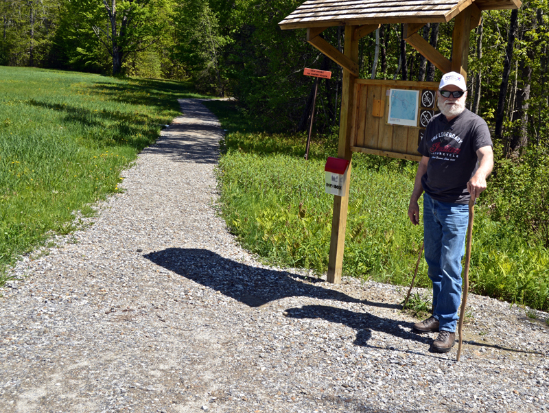Lincoln County Historical Association Trustee David Probert stands at the kiosk of a new wheelchair-accessible trail on the grounds of the Pownalborough Courthouse in Dresden. (Greg Foster photo)