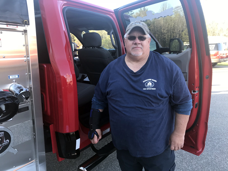 Edgecomb Fire Department Lt. Roland Abbott stands next to a truck similar to the model the department hopes to buy. Abbott has led the department's search for a new truck. (John Maguire photo)