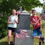 Edgecomb Selectmen, Students Decorate Gravestones for Memorial Day