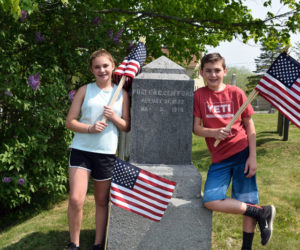 Edgecomb Eddy School sixth-graders and twins Catherine and William Clifford helped decorate veterans' graves in North Cemetery on Friday, May 25, including the grave of Fuller C. Clifford. The twins did not know if he was an ancestor, but were excited to find their family name. (Jessica Clifford photo)