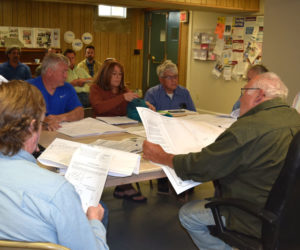 The Edgecomb Planning Board reviews blueprints for a pub on Route 27 during its meeting at the town hall Thursday, May 24. (Jessica Clifford photo)