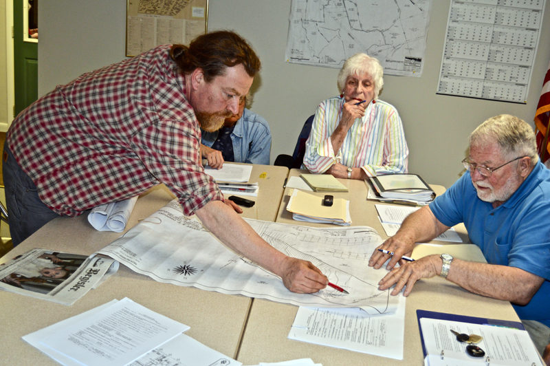 The Edgecomb Planning Board inspects plans for a new building on the Center for Teaching and Learning campus in Edgecomb during a meeting at the town hall Thursday, May 3. From left: CTL volunteer Ross Branch, board members Gretchen Burleigh-Johnson and Jackie Lowell, and board Chair Jack French. (Greg Foster photo)
