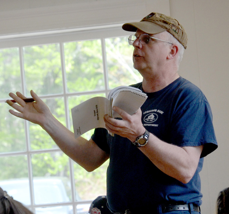 Edgecomb Fire Chief Roy Potter asks a question during the annual town meeting Saturday, May 19. (Maia Zewert photo)