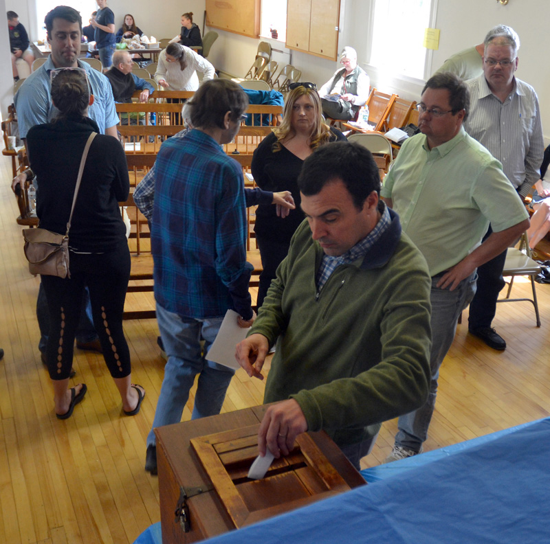 Edgecomb School Committee Chair Tom Abello casts his ballot during the annual town meeting at the town hall Saturday, May 19. (Maia Zewert photo)