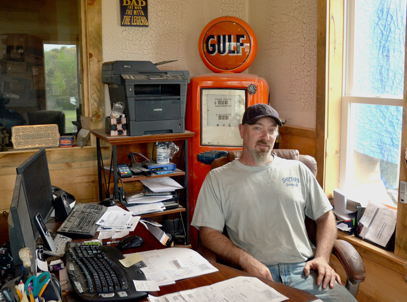 Twisted Iron Customs owner Mike Benner in his office at the business's new Edgecomb location. (Maia Zewert photo)