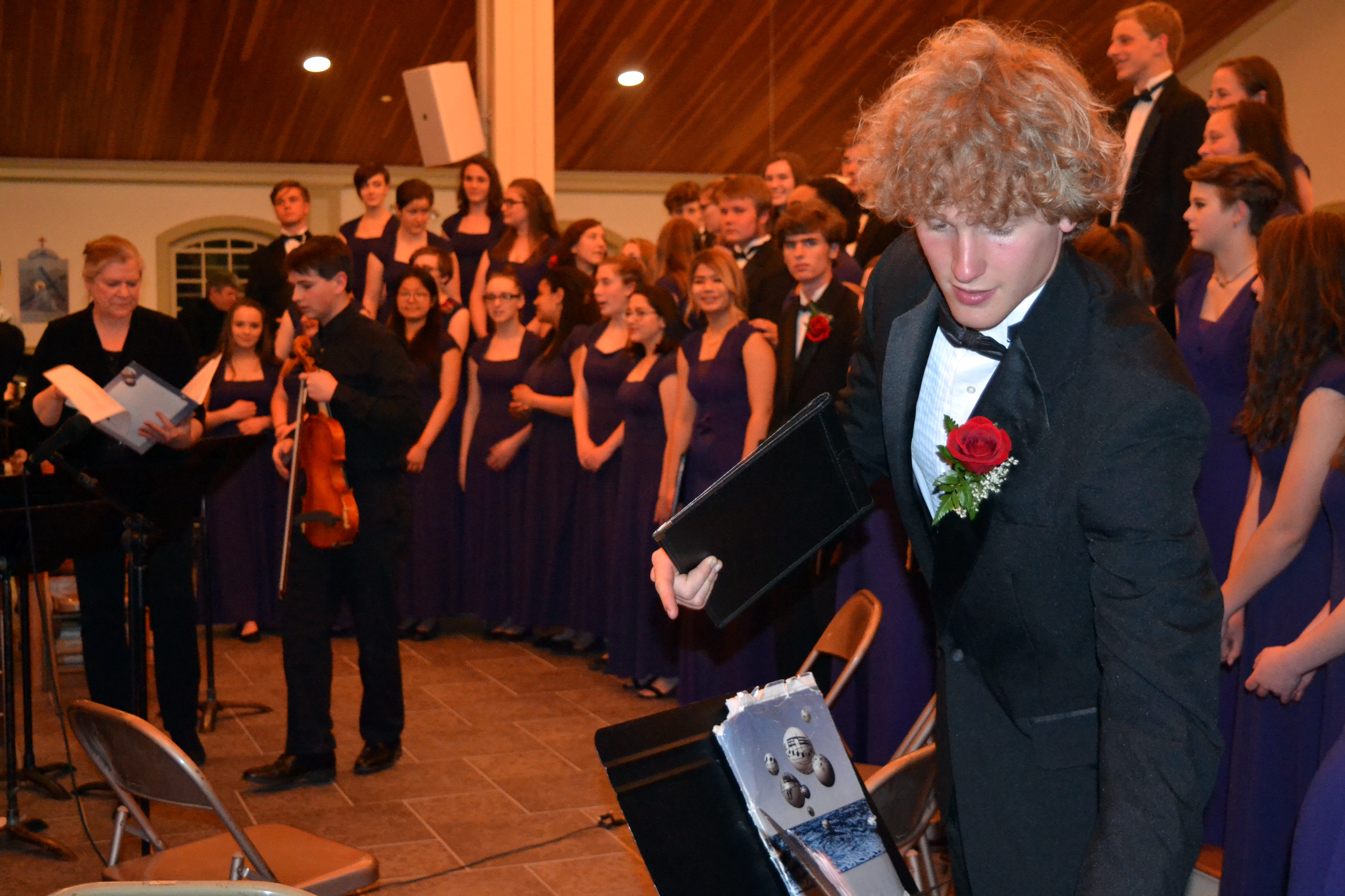 Lincoln Academy choir and string orchestra members, with orchestra director Carol Preston (left), get ready to pose for photographs at the end of the LA Spring Concert on Sunday, May 20. (Christine LaPado-Breglia photo)