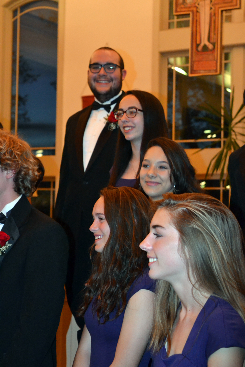 Graduating Lincoln Academy senior Miles Jackson (rear) basks in the glow of a successful choir concert and two awards at the end of the LA Spring Concert at St. Patrick's Catholic Church in Newcastle on Sunday, May 20. (Christine LaPado-Breglia photo)