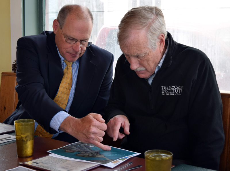 Damariscotta Town Manager Matt Lutkus (left) and U.S. Sen. Angus King review a map of downtown Damariscotta during a meeting about coastal resiliency at Sarah's Cafe in Wiscasset on Friday, April 27. (J.W. Oliver photo)