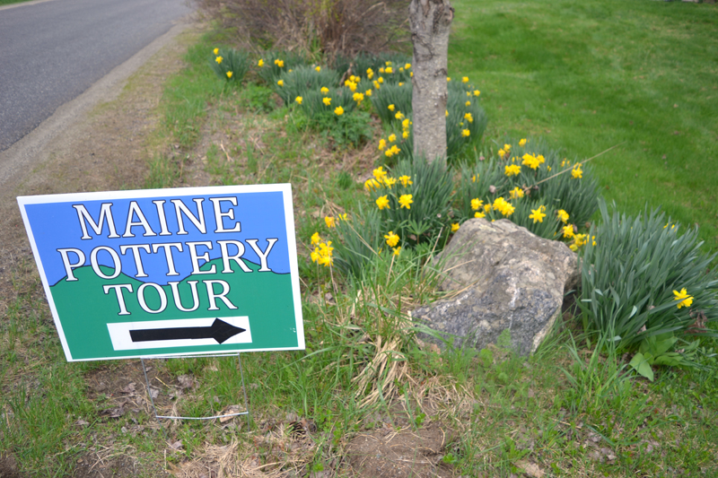 The sign and the daffodils outside Whitefield Pottery welcome visitors during the Maine Pottery Tour, Saturday and Sunday, May 5 and 6. (Christine LaPado-Breglia photo)
