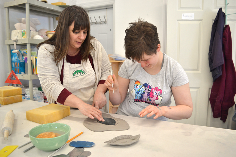 "Ceramicist Liz Proffetty instructs the author's daughter on how to make a ""push plate"" on Saturday, May 5 at Neighborhood Clay in Damariscotta during the Maine Pottery Tour. (Christine LaPado-Breglia photo)"