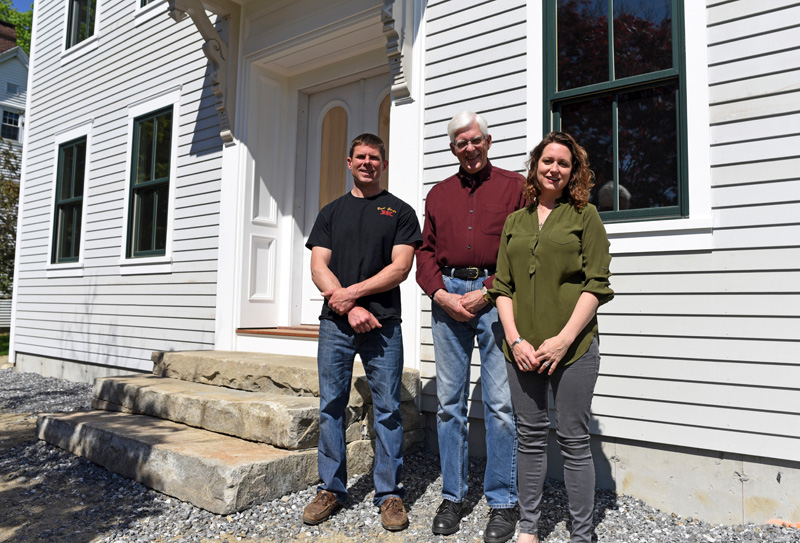 From left: builder Paul Garber, Dr. Robert DeWitt Jr., and architect Anna Newbert stand in front of the new building at 50 Main St. in Newcastle on Tuesday, May 29. (Jessica Picard photo)